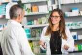 Pharmacist and Client in a Drugstore — Stock Photo