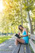 Beautiful Young Woman Reading a Book at Park — Stok fotoğraf