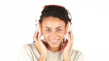 Young Woman Listening Music with Headphones and Flirting with Camera — Vídeo de stock
