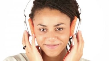 Young Woman Listening Music with Headphones and Flirting with Camera — Stock Video
