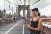 Young Woman Using Smart Phone on Brooklyn Bridge — Stock Photo
