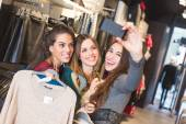 Three Women Taking a Selfie while Shopping — Stockfoto