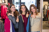 Three Happy Women in a Clothing Store after Shopping — Fotografia Stock