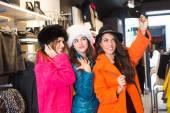 Three Women taking a Selfie Wearing Colorful Coats — Stock Photo