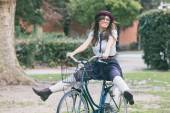 Old Fashioned Woman Riding Bicycle at Park — Stock Photo