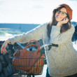 Old Fashioned Woman with Bicycle in the City — Stock Photo #58355437