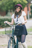 Old Fashioned Woman at Park with Bicycle — Stock Photo