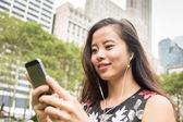 Beautiful Asian Young Woman with Mobile Phone and Earphones — Foto de Stock