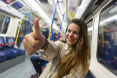 Happy Young Woman Commuting by Tube — Stock Photo