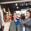 Happy Women with Credit Card in a Clothing Store  — Stock Photo #59240517