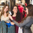 Happy Women with Credit Card in a Clothing Store  — Stock Photo #59240537
