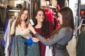 Happy Women with Credit Card in a Clothing Store  — Stockfoto