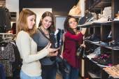 Women Buying Shoes in a Store — Stock Photo