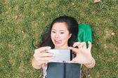 Girl on Grass Taking Selfie — Stock fotografie