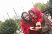Arab Women Wearing Veil Using a Smart Phone in Istanbul — Stock Photo