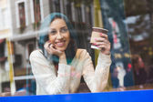 Muslim Woman Talking on Mobile Phone in a Cafe — Stock Photo