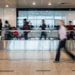 Blurred People Walking on Airport Walkway — Stock Photo #61637601