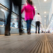 Blurred People Walking on Airport Walkway — Stock Photo #61638269