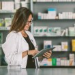 Pharmacist with Digital Tablet — Stock Photo #62254317
