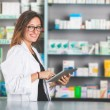 Pharmacist with Digital Tablet — Stock Photo #62254479
