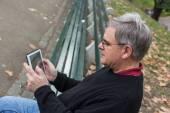 Senior Typing on Tablet — Stock Photo