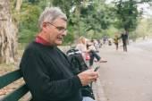 Senior Typing on Mobile — Stock Photo