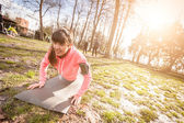Young Woman Doing Push-Ups Exercises at Park. — Stock Photo