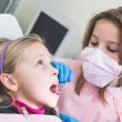 Little Girls Dentist and Patient During Dental Examination. — Stock Photo #65073291