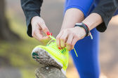 Young Sporty Woman Doing Up her Shoes Before Running. — Stock Photo