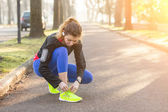 Young Sporty Woman Doing Up her Shoes Before Running. — Stockfoto