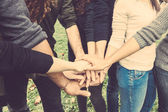Multiracial group of friends with hands in stack — Foto de Stock