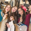 Three women taking a selfie while shopping — Stock Photo #65772017