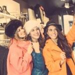 Three women taking a selfie wearing colorful coats — Stockfoto #65772149