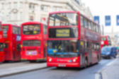 Blurred background with famous London public transport vehicles — Stockfoto