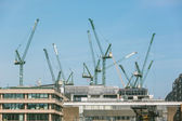 Cranes on a building site in London next to Thames — Photo
