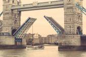 Tower Bridge in London with drawbridge open — Stock Photo