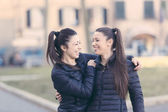 Female Twins Playing together and Enjoy Getting Piggyback Ride — Foto Stock