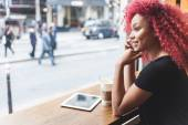 Beautiful girl in a cafe talking on smart phone — Stockfoto
