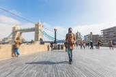Man walking in London on Thames sidewalk — Stock Photo