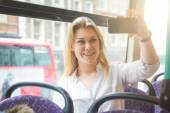 Beautiful young woman taking a selfie while commuting in London — Stock Photo