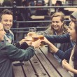 Group of friends enjoying a beer at pub in London — Stock Photo #70619917