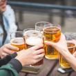 Group of friends enjoying a beer at pub in London — Stock Photo #70620011