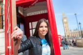 Young woman  in London with phone booth and Big Ben — Stock Photo