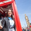 Young woman  in London with phone booth and Big Ben — Stock Photo #71042035