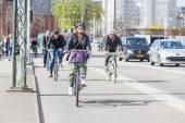 People going by bike in Copenhagen — Stock Photo