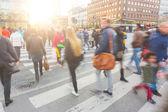 Blurred crowd of people walking on zebra crossin in Copenhagen — Stock Photo