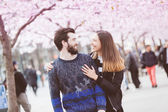 Happy hipster couple in Stockholm with cherry blossoms — Stock Photo