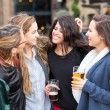Group of women enjoying a beer at pub in London. — Stock Photo #72895875