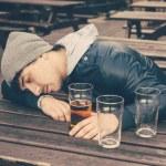 Drunk young man sleeping at pub — Stock Photo #73807061
