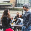 Young couple enjoying a beer at pub — Stock Photo #73807455